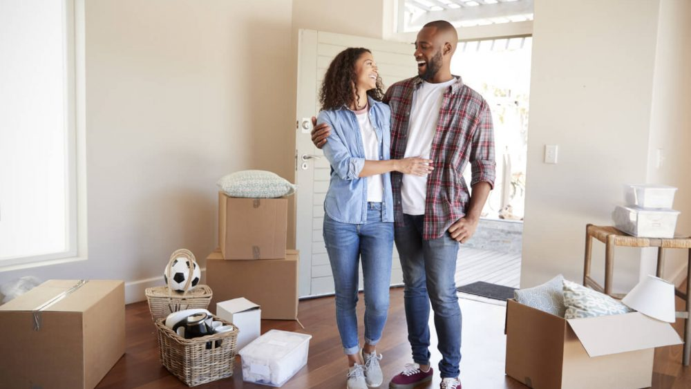 Couple celebrates after buying their first home because they followed a home buying guide
